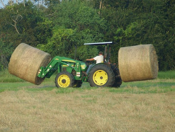 john deere tractor, hauling hay out of field thumbnail