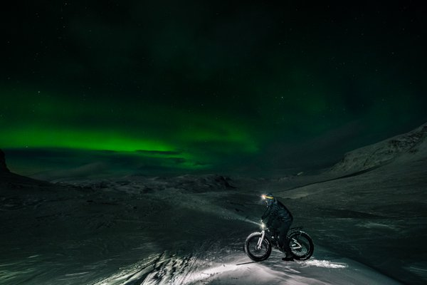 Cycling under polar lights thumbnail