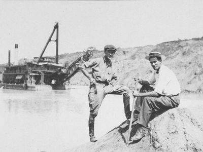 Two canal workers pose in the cut