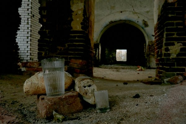 Bread and water left behind the altar of a destroyed church by villagers thumbnail
