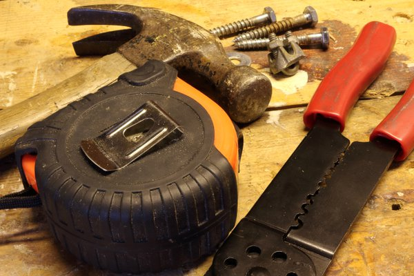 Tools and hardware on a workbench thumbnail