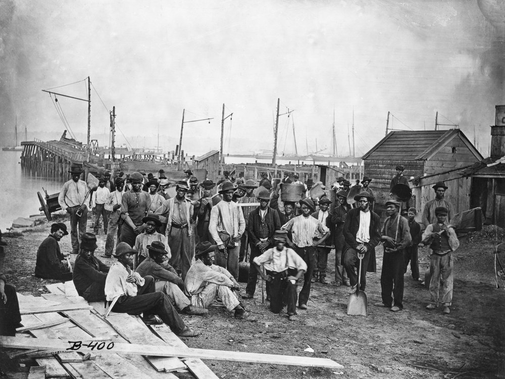 Black Americans along with a wharf