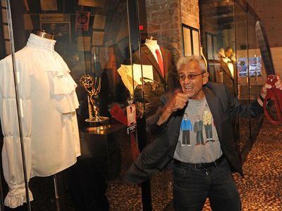 George Shapiro cuts the ribbon on a Seinfeld exhibit.