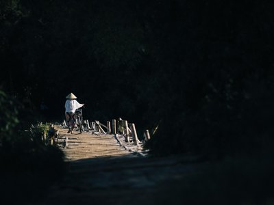 Locals cross a small wooden foot bridge in Quang Ngai Province in central Vietnam, just downriver from the My Lai Massacre in 1968.