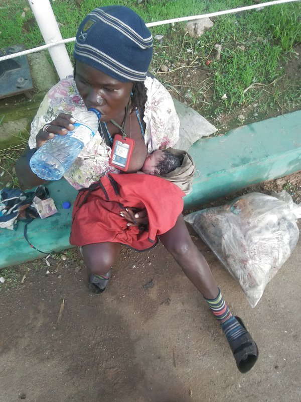Baby on the street, the homeless lady seems to be mentally ill was seeing with a day old baby, according to her she delivered the baby on Wednesday 23rd of September. thumbnail