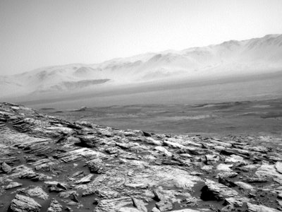The lonely rover is heading through Gale Crater to dig around for hints of microbial life.