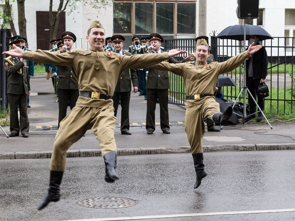 Performance by a military dance group on a Moscow street near the house of a veteran of the Great Patriotic War during quarantine thumbnail
