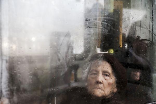 sad woman in a rainy day thumbnail