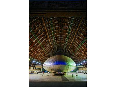 Inside a World War II-era blimp hangar in Tustin, California, the future of aviation is preparing for liftoff.