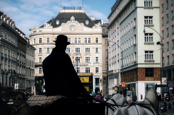 A silhouette of coachman with a horse-drawn carriage in Vienna. thumbnail