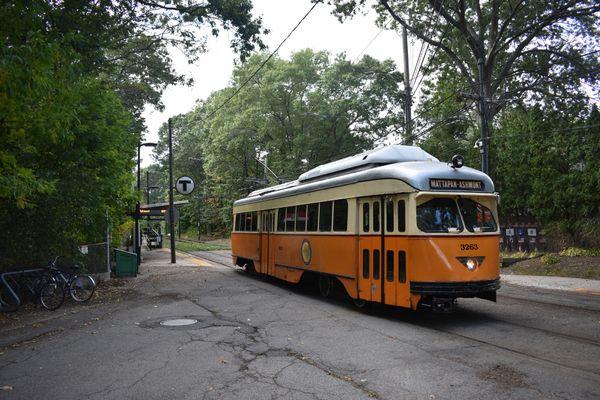 A mass transit trolley passing through a residential neighborhood near Boston thumbnail