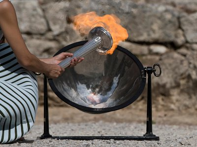 The Olympic Flame was lit from the sun's rays using a parabolic mirror, during the final dress rehearsal for the lighting ceremony at Ancient Olympia, in southwestern Greece, on Monday, Oct. 23, 2017.