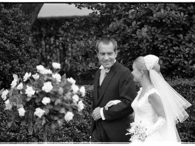President Richard Nixon escorts his daughter Tricia Nixon during the sixteenth White House wedding.