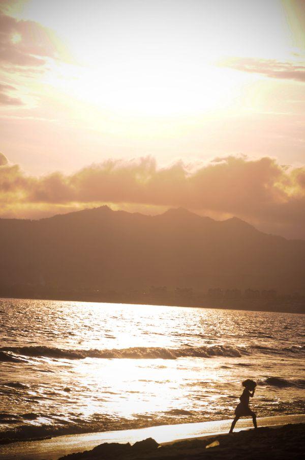 Nina in the waves in Puerto Vallarta sunset thumbnail