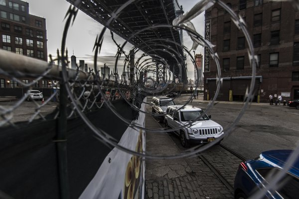 Spiral of barbed wire down under the Manhattan Bridge, NYC thumbnail