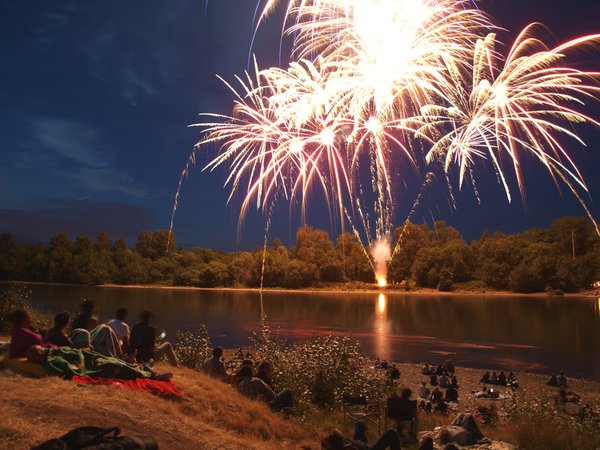 July 4th celebration on the river bank of the Willamette river in Independence Oregon. thumbnail