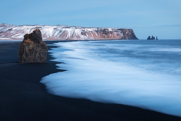 Reynisfjara black sand beach in Iceland. I visited this spot twice in the past and it was foggy and raining, so I could not see the sea stacks!