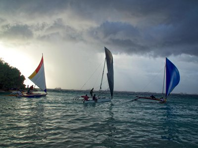 Outrigger canoes race in the Majuro lagoon in the Marshall Islands. Traditional Marshallese wave piloting uses the feeling of the ocean to navigate precisely across vast stretches of open water.