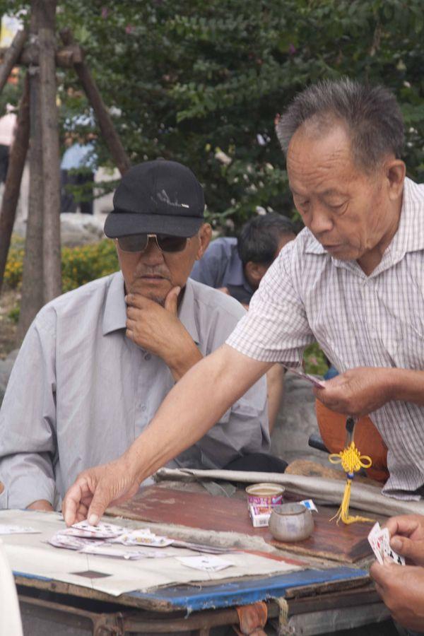 Old men playing cards. thumbnail
