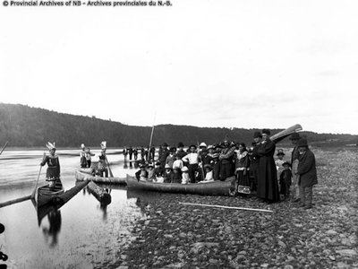 Malacites of the Wanabaki Confederacy standing along the edge of the water at French village, Kingsclear, celebrating Corpus Christi Day, ca 1887.