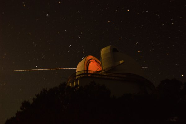 The International Space Station flies behind the Harlan J. Smith Telescope at the McDonald Observatory thumbnail