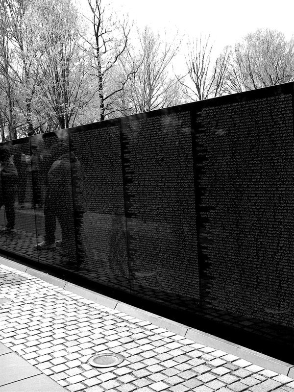 People searching for family names at The Wall that went missing or die in the Vietnam War thumbnail