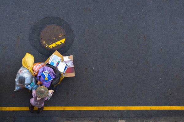A scavenger with a trolley full of trash is worth money for her thumbnail