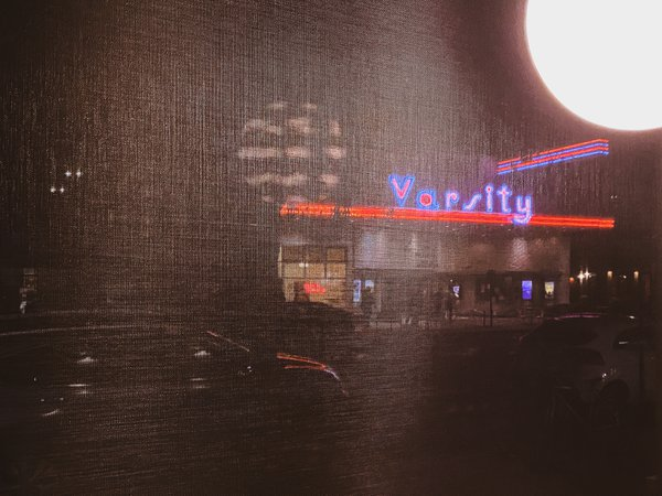 A shot of the old Varsity movie theatre in Davis California taken through a Starbuck's Coffee shop window. thumbnail