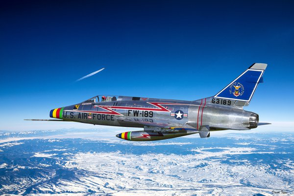 A F-100D flying above the Rocky Mountains. thumbnail