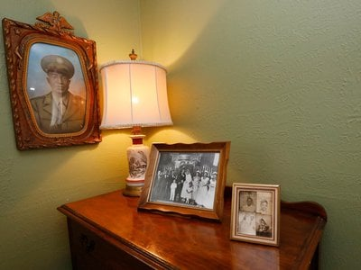 Family photographs decorate the master bedroom in the home of Civil Rights leaders Medgar and Myrlie Evers.