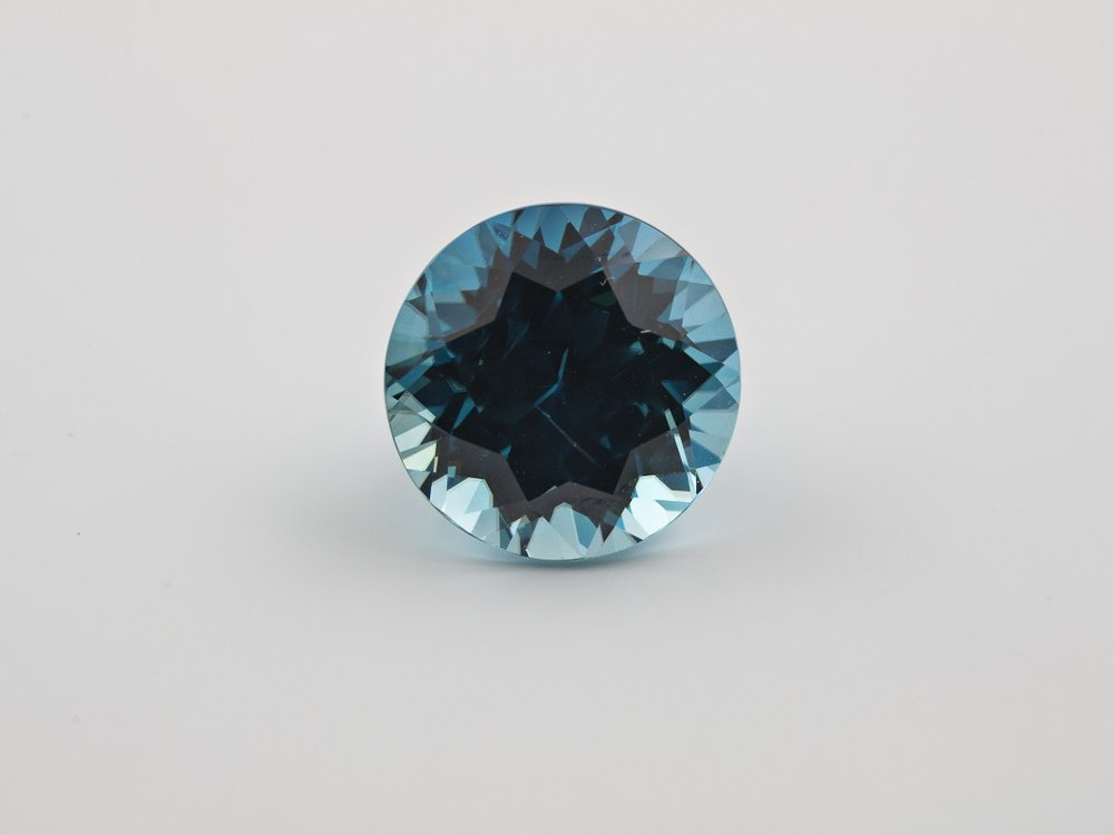 Zircons are the oldest minerals in the world and come in colors like the rich blue above. Researchers have now used these gemstones to identify when modern plate tectonics began. (Ken Larsen)