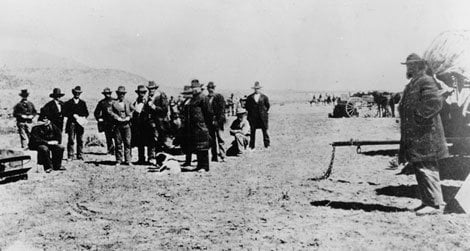 John D. Lee, seated on his coffin, moments before his execution.