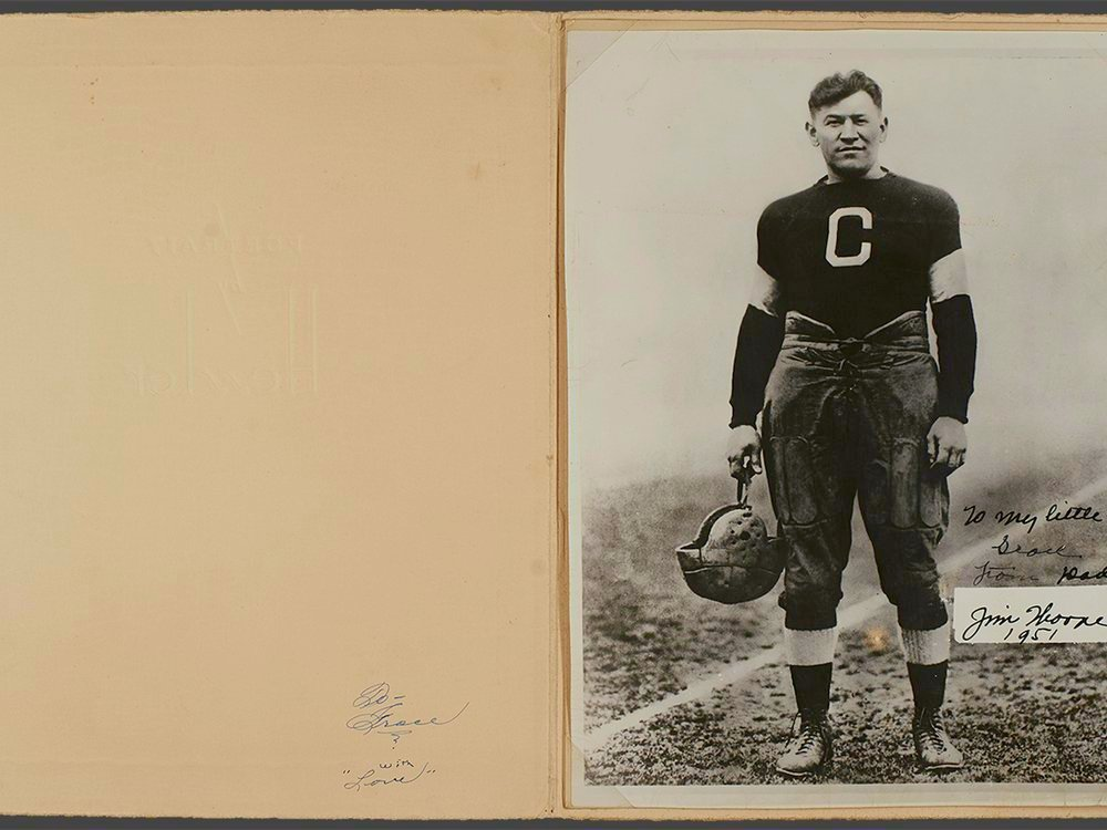 """Jim Thorpe (Sac and Fox), with the inscription """"To my little girl Grace From Dad Jim Thorpe 1951."""" The photo, in the original folder frame, shows Thorpe during his career with the Canton Bulldogs football team, ca. 1915 to 1920. Grace Thorpe Collection, NMAI.AC.085 (pht_092_002). (National Museum of the American Indian Archives Center, Smithsonian)"""