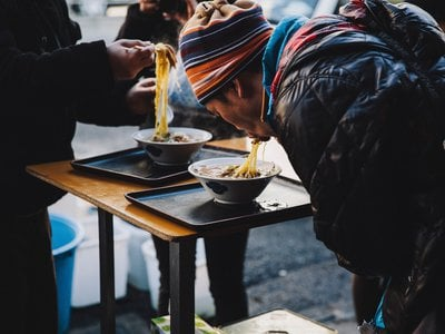 On a chilly day in Tokyo, customers slurp hot ramen at the Tsukiji fish market.