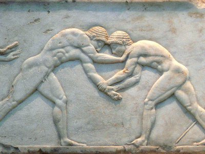 Constructed between 510 and 500 B.C., the base of a funerary kouros in Athens is decorated with the image of wrestlers fighting.