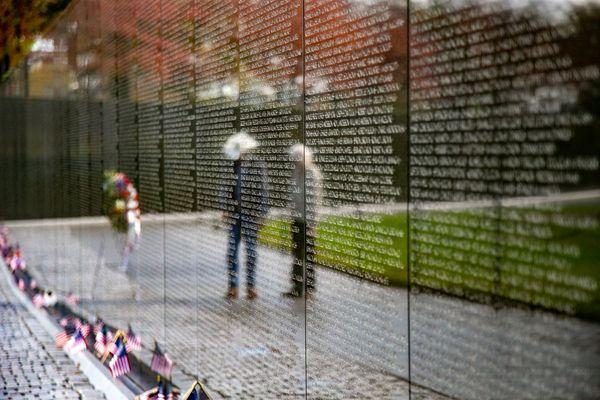 People visit the Vietnam Veterans Memorial in Washington, D.C. thumbnail