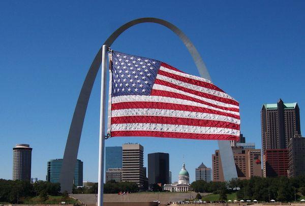Jefferson Memorial Gateway Arch in St. Louis, Missouri framing the American Flag thumbnail