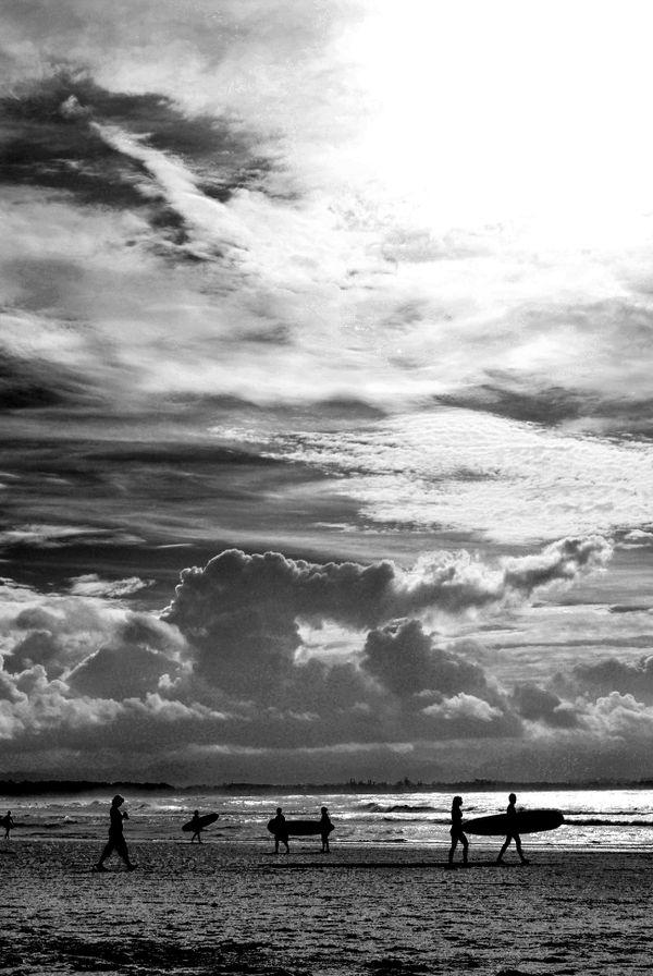 Surfer Silhouettes in Byron Bay Australia thumbnail