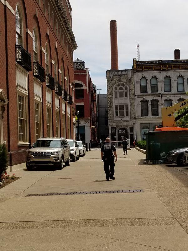 An American officer walking among the distinctive American Skyline thumbnail