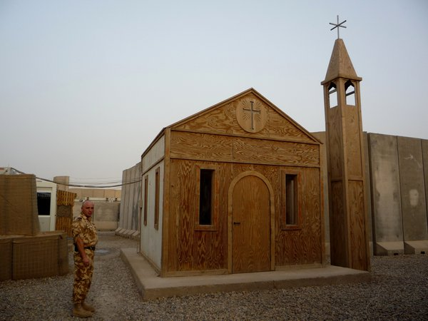 A plywood chapel stands out amidst the monochrome world on Camp Dracula, the Romanian base in southern Iraq. thumbnail