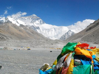 A pile of discarded prayer flags lays in front of Mount Everest, which claimed four lives in just four days over the weekend.
