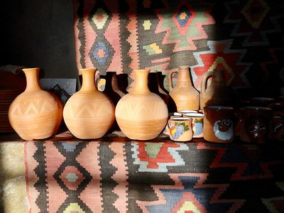 At Sisian Ceramics, Vahagn Hambardzumyan throws clay on a wheel to make traditional Armenian shapes onto which Zara Gasparyan etches decorative patterns. The terracotta jugs on the left are made to hold water.