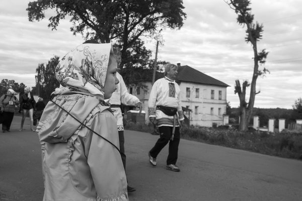 The small girl staying after trekking, 35 km long (Christian Procession) thumbnail