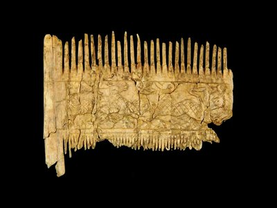 The ivory comb shows gazelle-like animals attempting to escape predators.