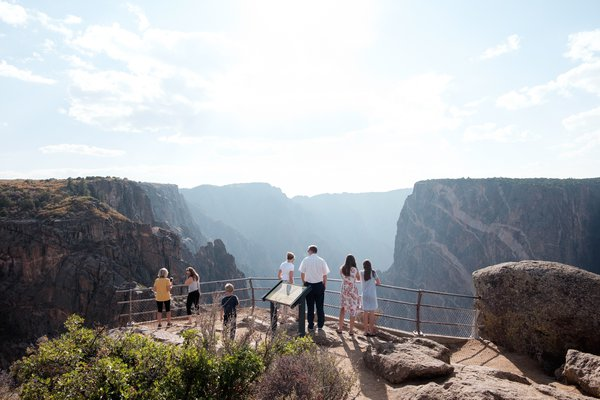 Visitors to an overlook at Black Canyon of the Gunnison National Park. thumbnail