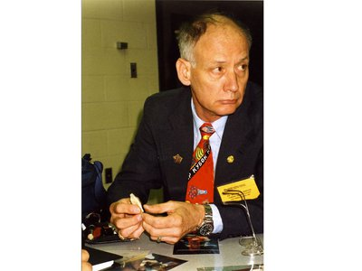 William Maples holds a bone fragment during a presentation about the Romanov Investigations, circa 1992.