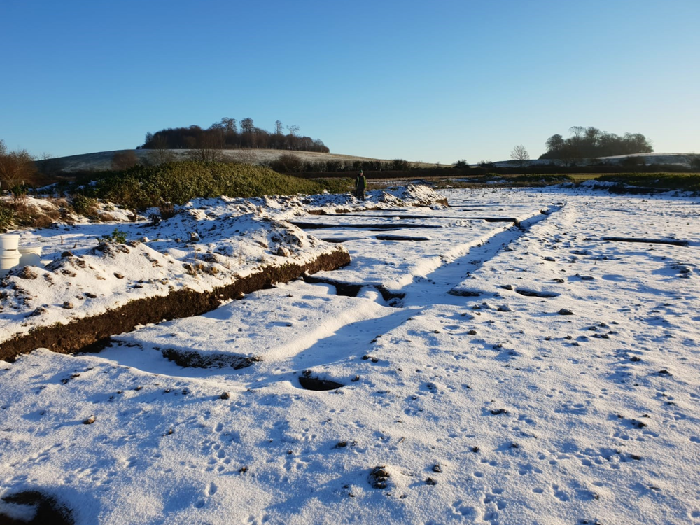 Snow-covered outline of the Roman villa's foundations
