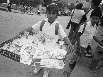In Valle de Allende, Mexico, a school child carries her homework assignment, an altar for Día de los Angelitos, the first of three days when participants honor and commune with deceased ancestors.