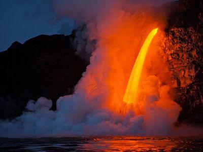 Kilauea at sunrise: A massive flow streams from a lava tube at the Kamokuna ocean entry.