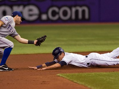 Texas Rangers second baseman Ian Kinsler tags out Tampa Bay Rays' Sam Fuld on a stolen base attempt.